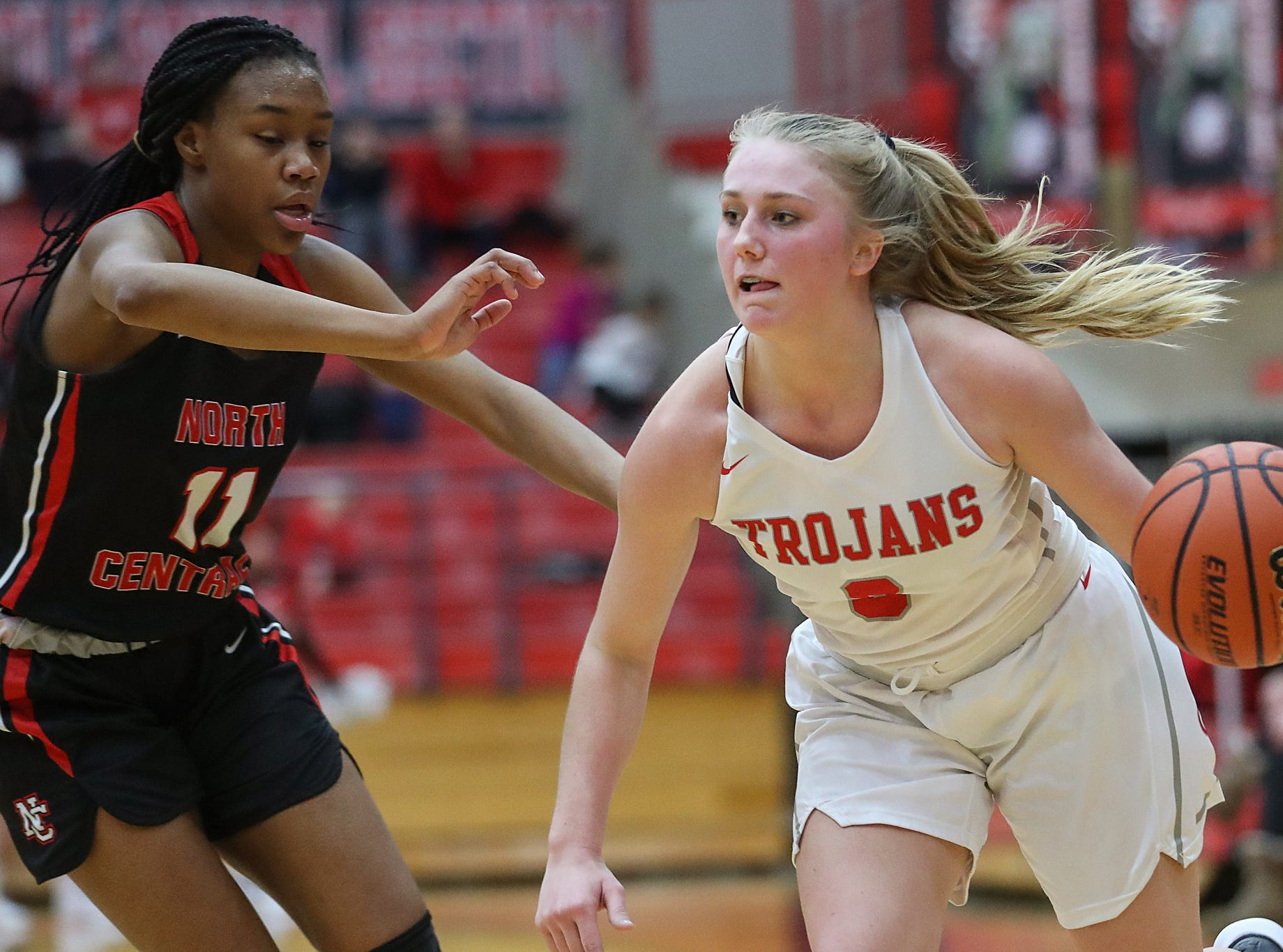 Center Grove Trojans guard Ashley Eck (3) drives around North Central Panthers guard Toree Jackson (11) in the first half of the game at Center Grove High School in Greenwood, Ind., Thursday, Jan. 10, 2019. Center Grove defeated North Central, 51-44.