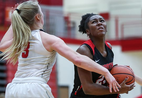 North Central Panthers guard Jasmine McWilliams (23) breaks past Center Grove Trojans guard Ashley Eck (3) toward the basket in the second half of the game at Center Grove High School in Greenwood, Ind., Thursday, Jan. 10, 2019. Center Grove defeated North Central, 51-44.