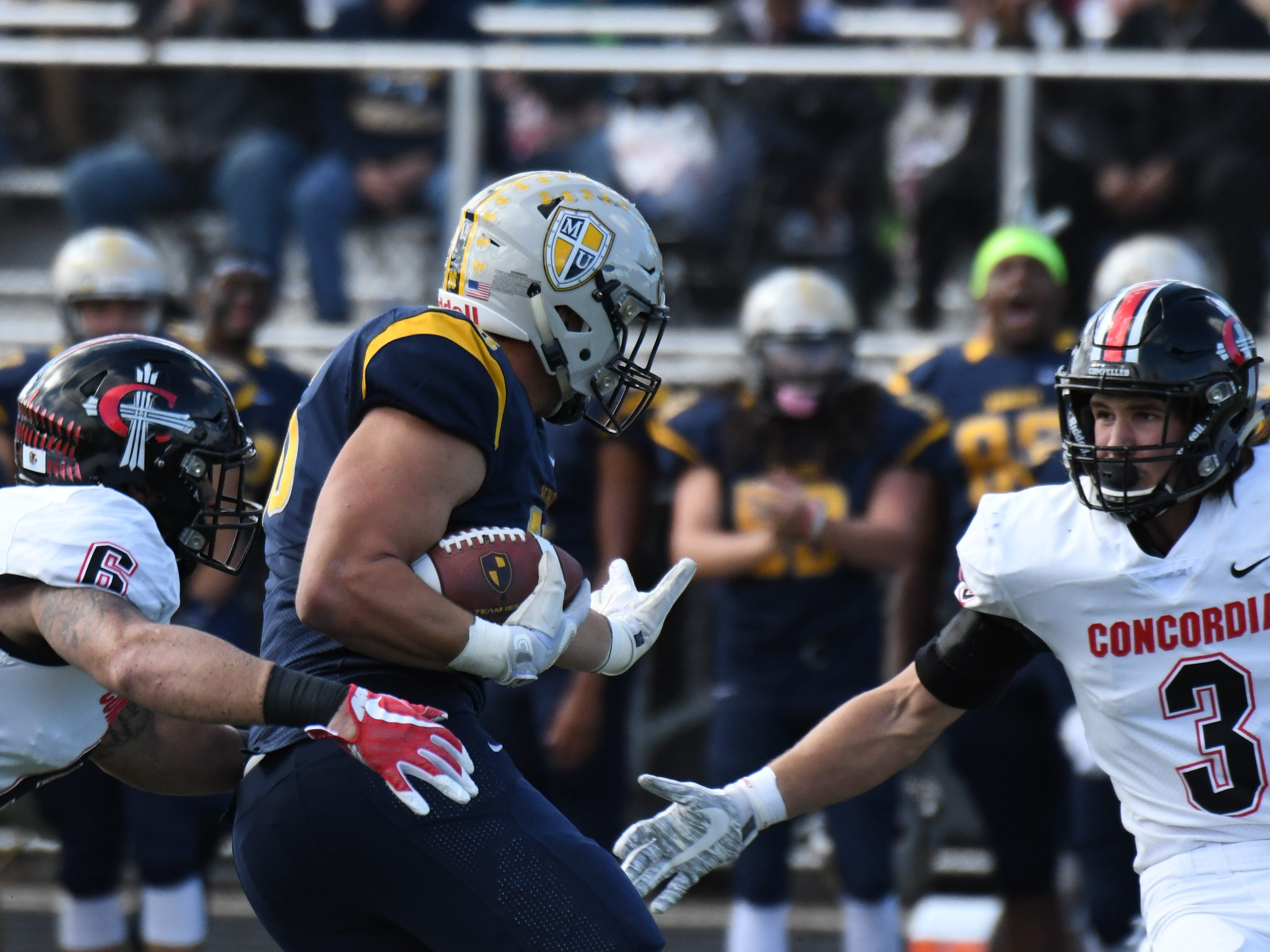Marion University tight end Brandon Dillon looks to break a tackle against Concordia.
