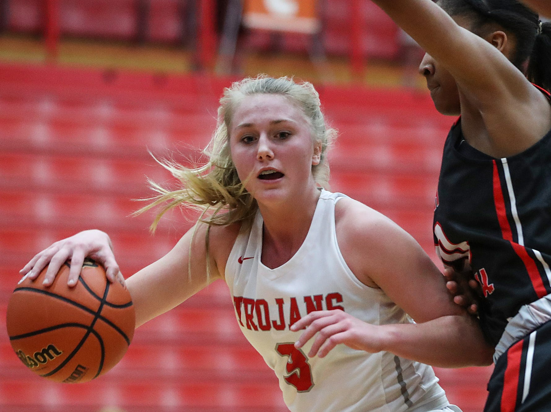 Center Grove Trojans guard Ashley Eck (3) dribbles around North Central Panthers forward Ramiah Elliott (20) in the first half of the game at Center Grove High School in Greenwood, Ind., Thursday, Jan. 10, 2019. Center Grove defeated North Central, 51-44.