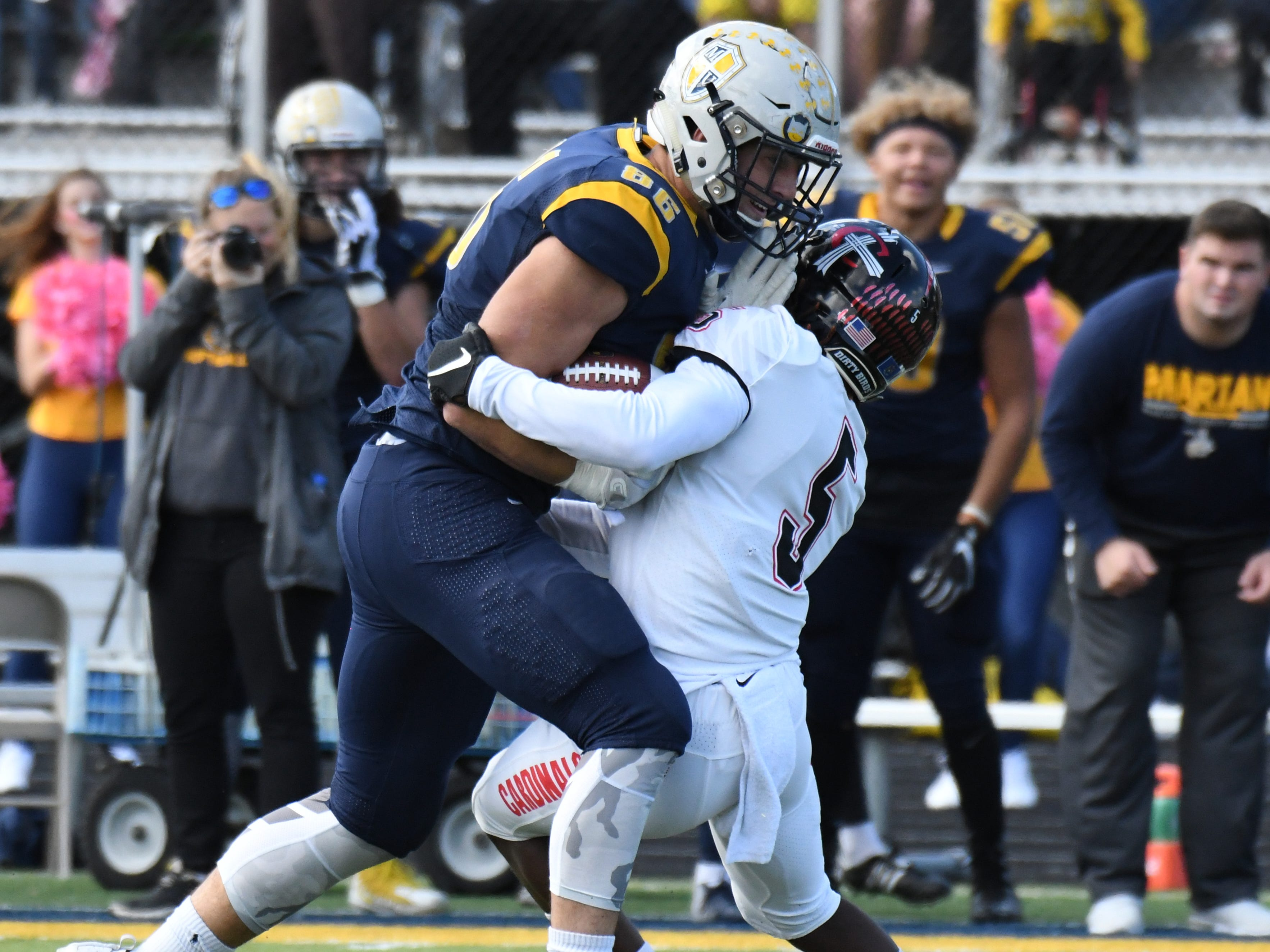 Marian University tight end Brandon Dillon collides with a Concordia defender.