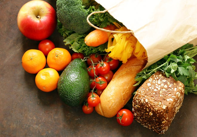 Grocery food shopping bag - vegetables, fruits, bread and pasta.