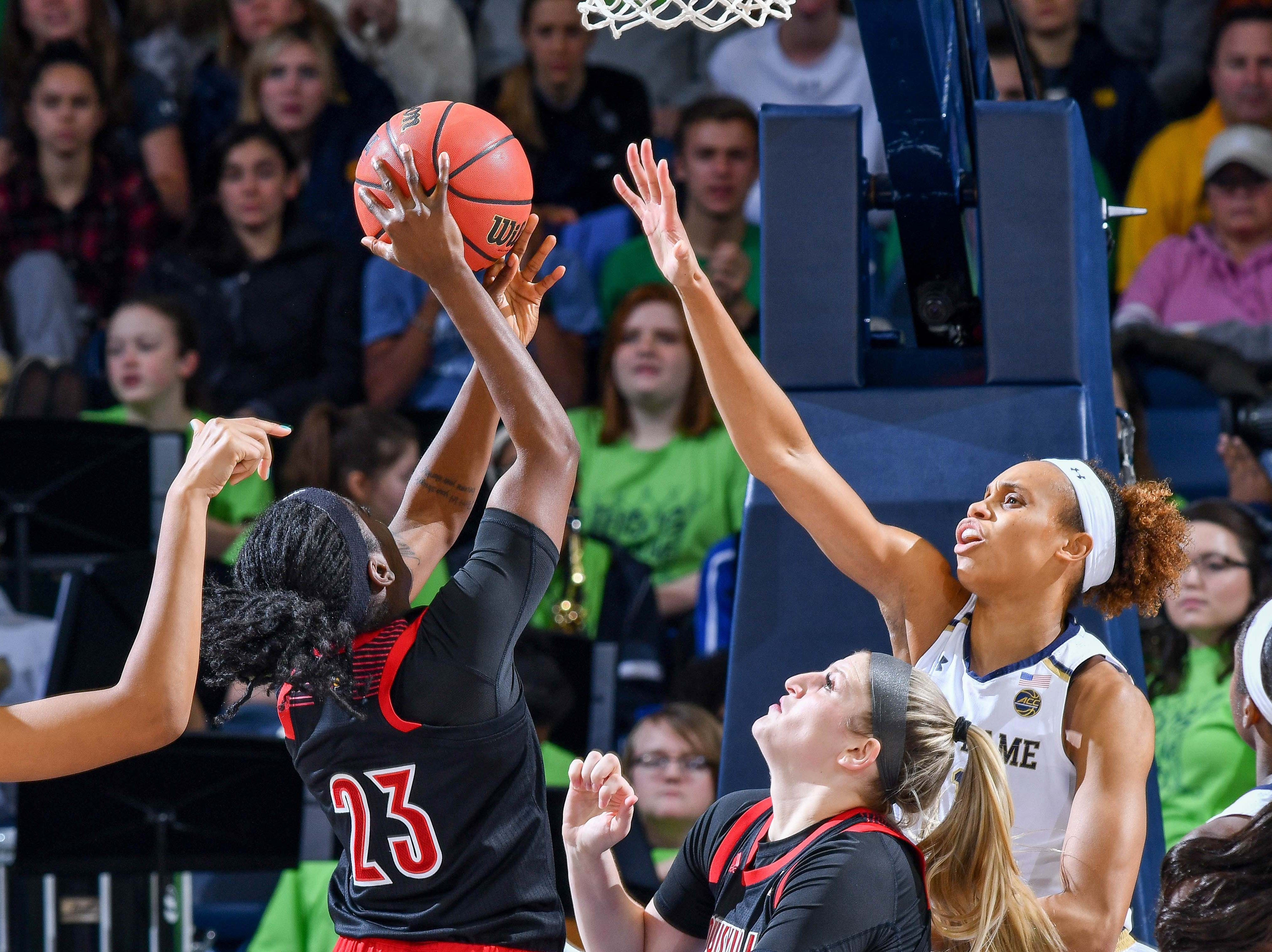 Jan 10, 2019; South Bend, IN, USA; Louisville Cardinals guard Jazmine Jones (23) goes up for a shot as Notre Dame Fighting Irish forward Brianna Turner (11) defends in the second half at the Purcell Pavilion. Mandatory Credit: Matt Cashore-USA TODAY Sports
