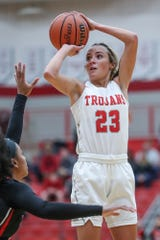 North Central Panthers guard Savaya Brockington (4) tries to block a three-point shot by Center Grove Trojans guard Emma Utterback (23) in the first half of the game at Center Grove High School in Greenwood, Ind., Thursday, Jan. 10, 2019. Center Grove defeated North Central, 51-44.