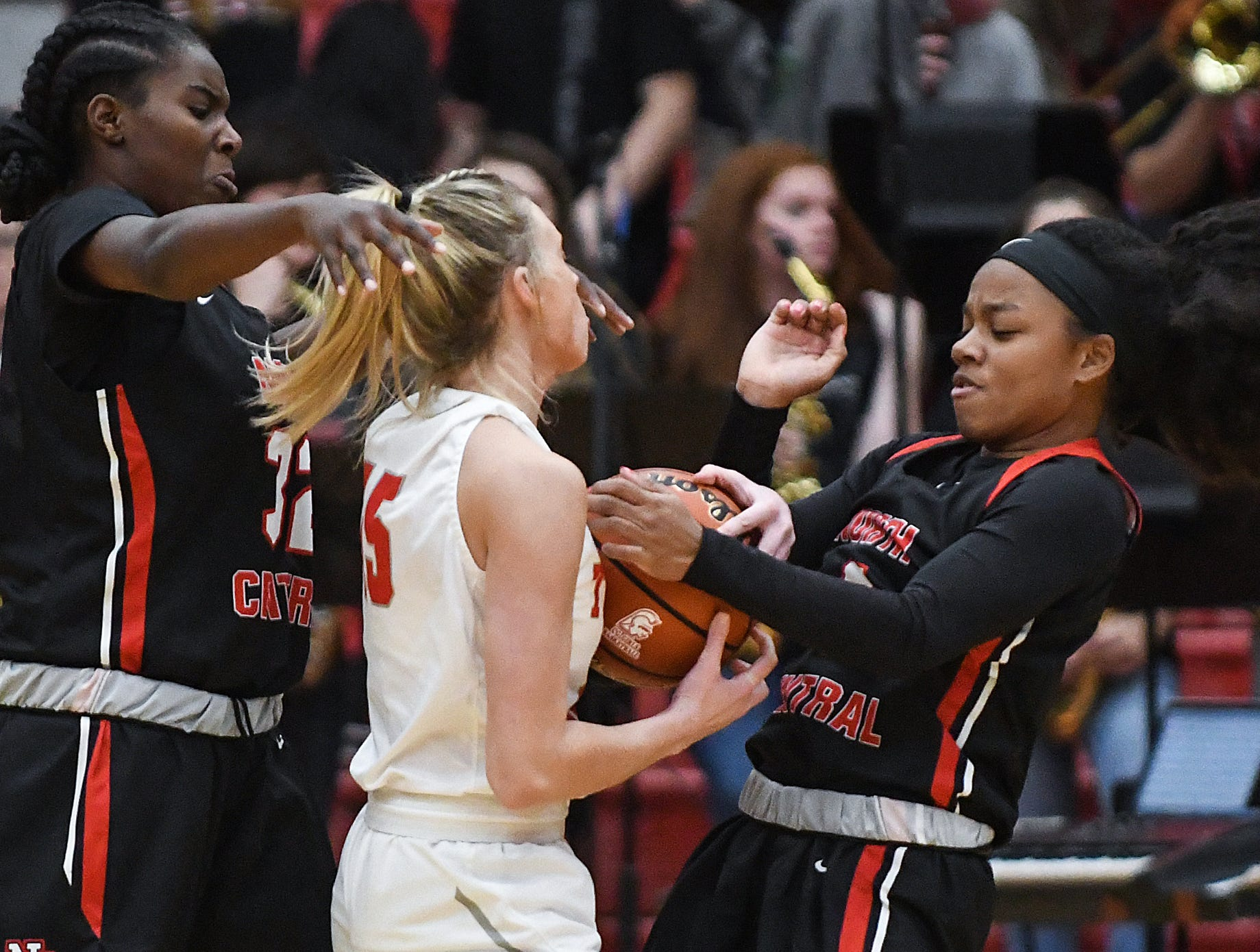 Center Grove Trojans forward Kylie Storm (15) and North Central Panthers guard Savaya Brockington (4) grapple over the ball in the first half of the game at Center Grove High School in Greenwood, Ind., Thursday, Jan. 10, 2019. Center Grove defeated North Central, 51-44.