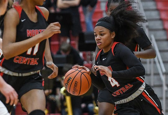 North Central Panthers guard Savaya Brockington (4) works a possession in the first half of the game at Center Grove High School in Greenwood, Ind., Thursday, Jan. 10, 2019. Center Grove defeated North Central, 51-44.