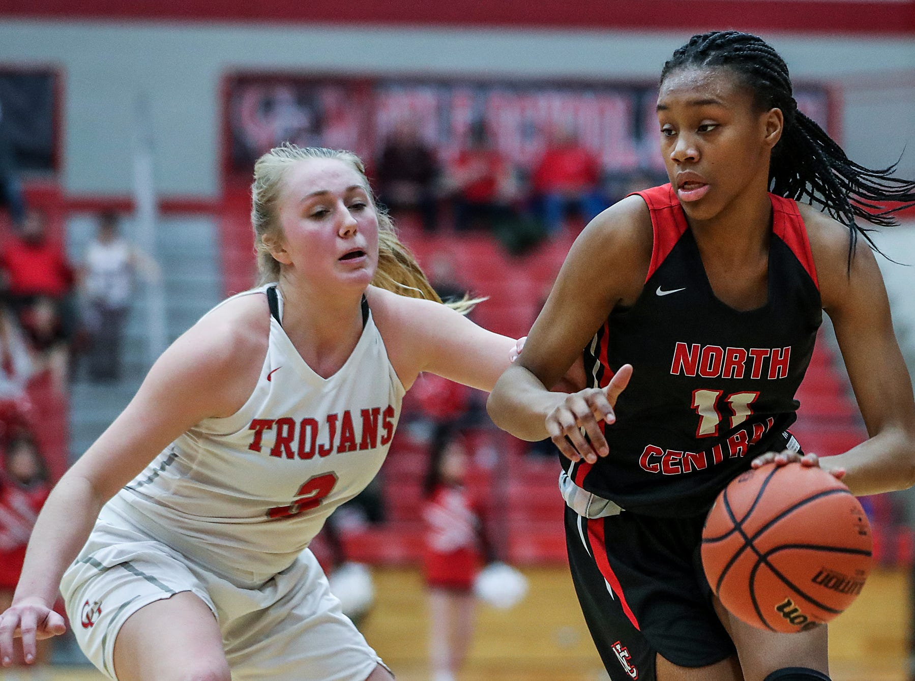 Center Grove Trojans guard Ashley Eck (3) guards North Central Panthers guard Toree Jackson (11) in the second half of the game at Center Grove High School in Greenwood, Ind., Thursday, Jan. 10, 2019. Center Grove defeated North Central, 51-44.