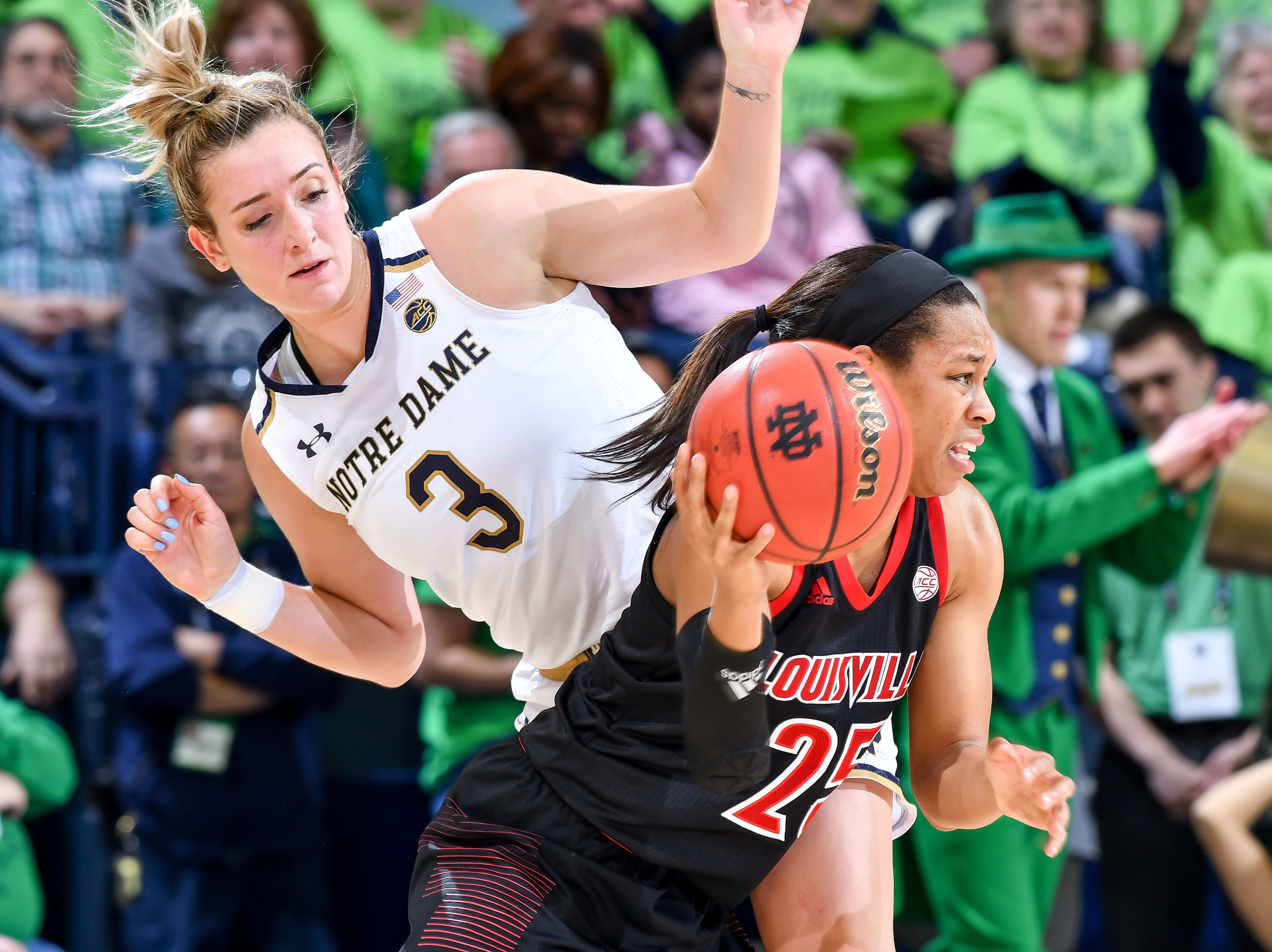 Jan 10, 2019; South Bend, IN, USA; Louisville Cardinals guard Asia Durr (25) dribbles as Notre Dame Fighting Irish guard Marina Mabrey (3) defends in the second half at the Purcell Pavilion. Mandatory Credit: Matt Cashore-USA TODAY Sports