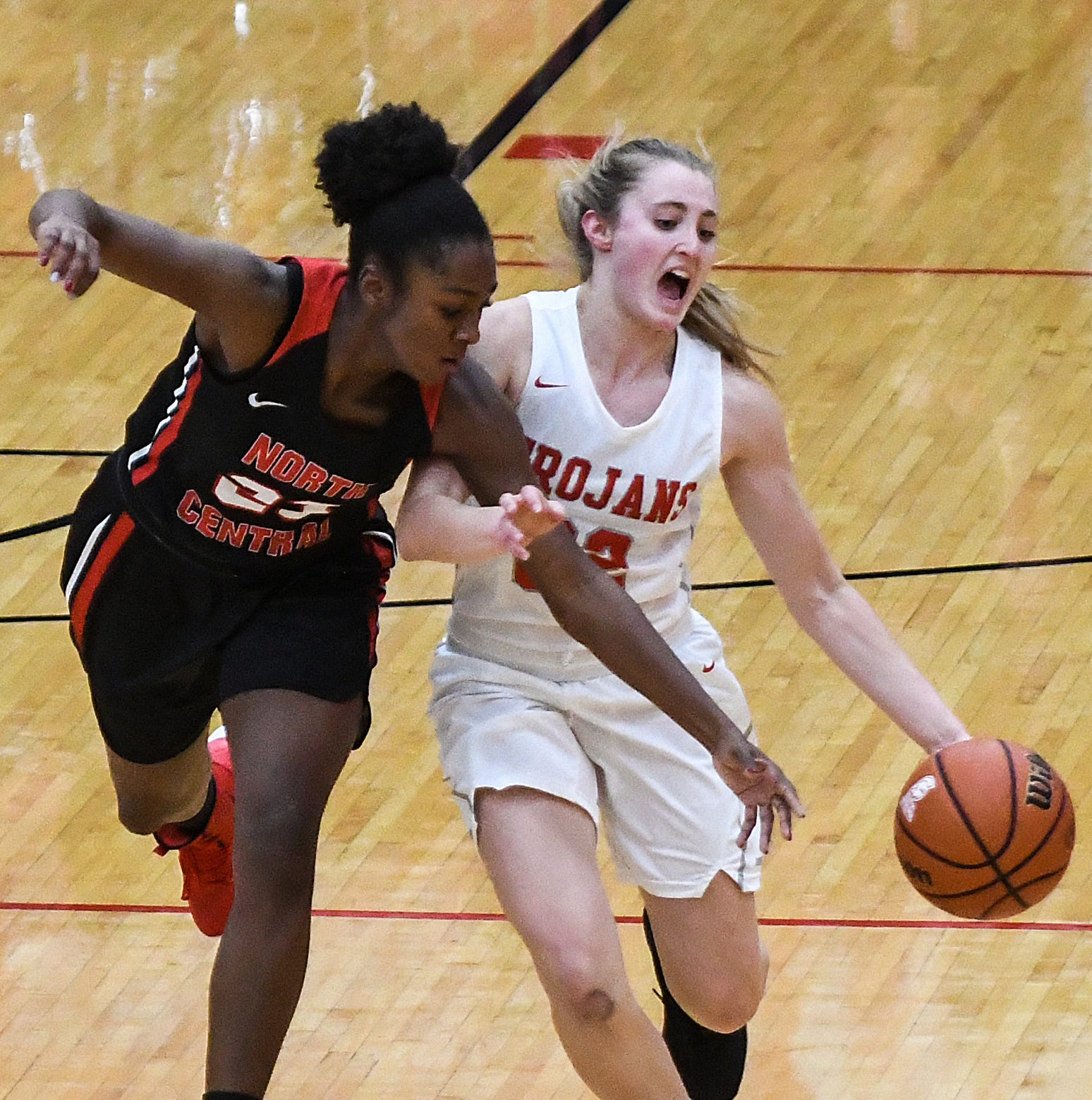 North Central Panthers guard Jasmine McWilliams (23) tries to knock the ball away from Center Grove Trojans Ella Thompson (22) in the second half of the game at Center Grove High School in Greenwood, Ind., Thursday, Jan. 10, 2019. Center Grove defeated North Central, 51-44.