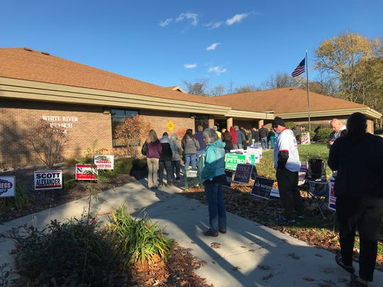Voters line up outside the Johnson County Library's White River Branch on Nov. 6, 2018.