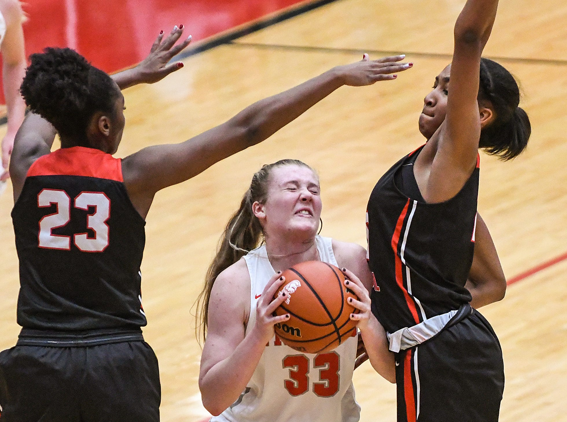 Center Grove Trojans guard Mary Wilson (33) drives up to the basket in the second half of the game at Center Grove High School in Greenwood, Ind., Thursday, Jan. 10, 2019. Center Grove defeated North Central, 51-44.