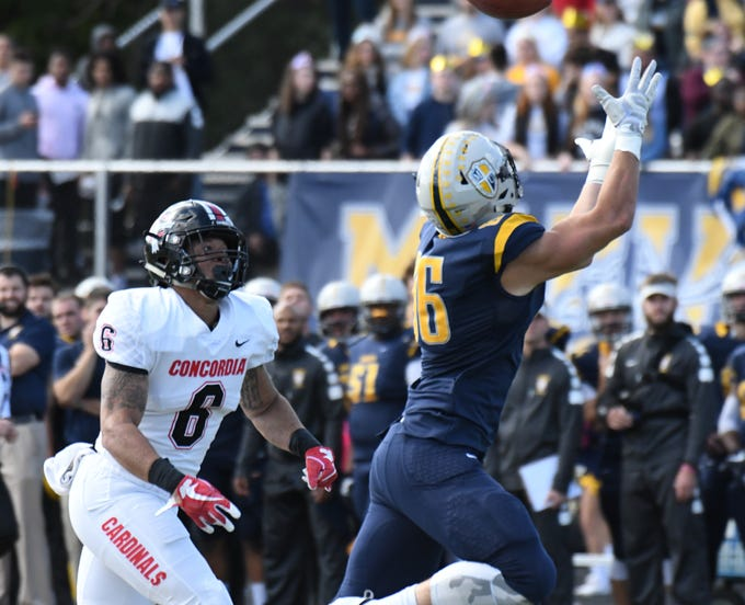 Marian University tight end Brandon Dillon extends for a pass against Concordia.