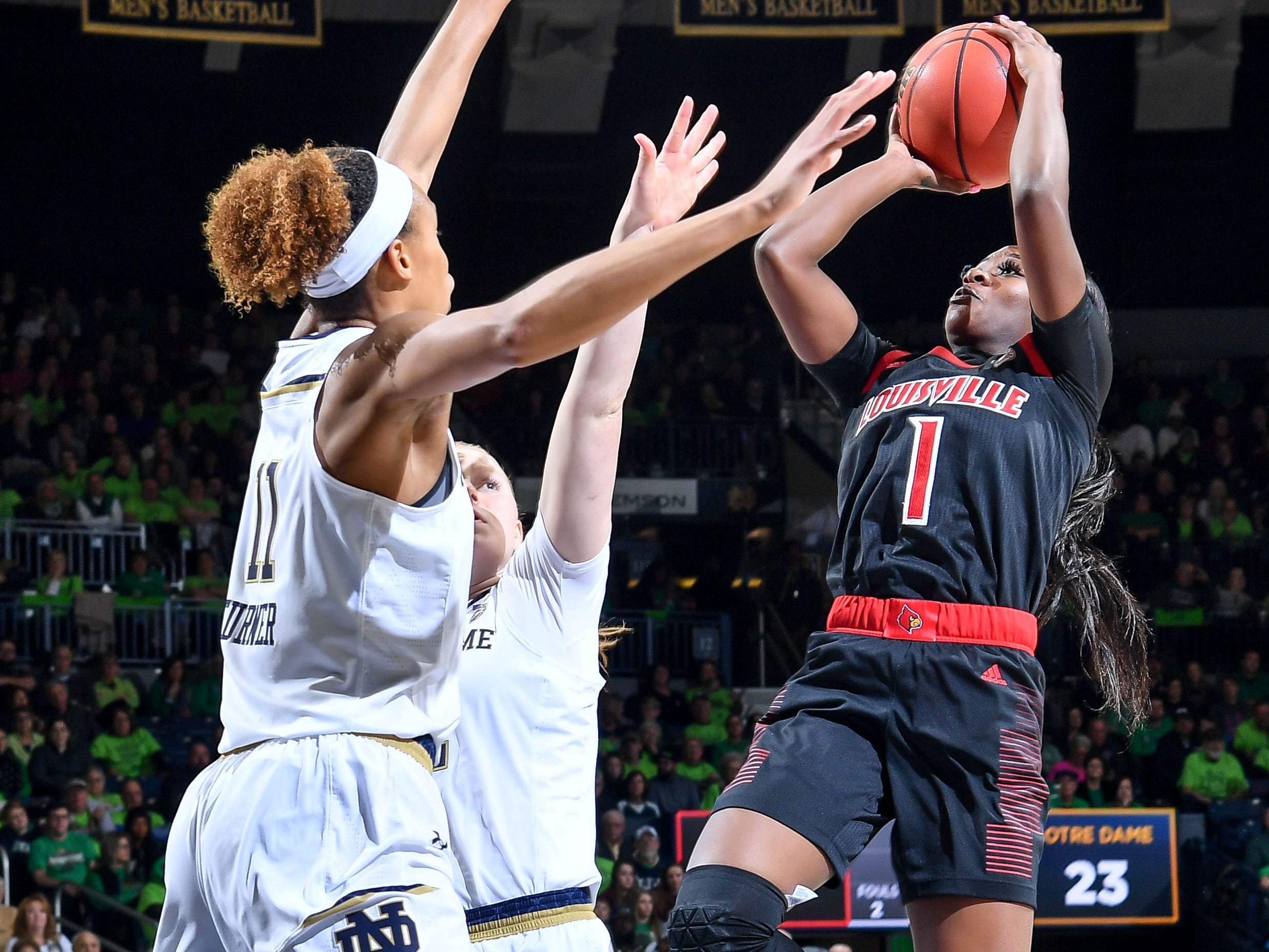Jan 10, 2019; South Bend, IN, USA; Louisville Cardinals guard Dana Evans (1) goes up for a shot as Notre Dame Fighting Irish forward Brianna Turner (11) defends in the first half at the Purcell Pavilion. Mandatory Credit: Matt Cashore-USA TODAY Sports