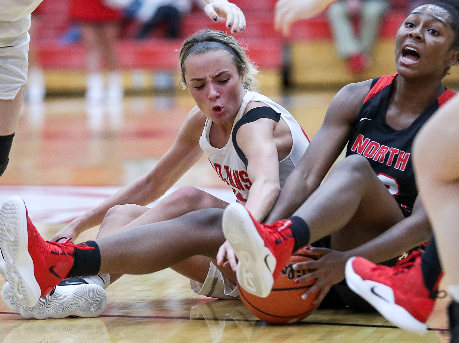 Center Grove Trojans guard Emma Utterback (23) and North Central Panthers guard Jasmine McWilliams (23) fight for the ball in the second half of the game at Center Grove High School in Greenwood, Ind., Thursday, Jan. 10, 2019. Center Grove defeated North Central, 51-44.