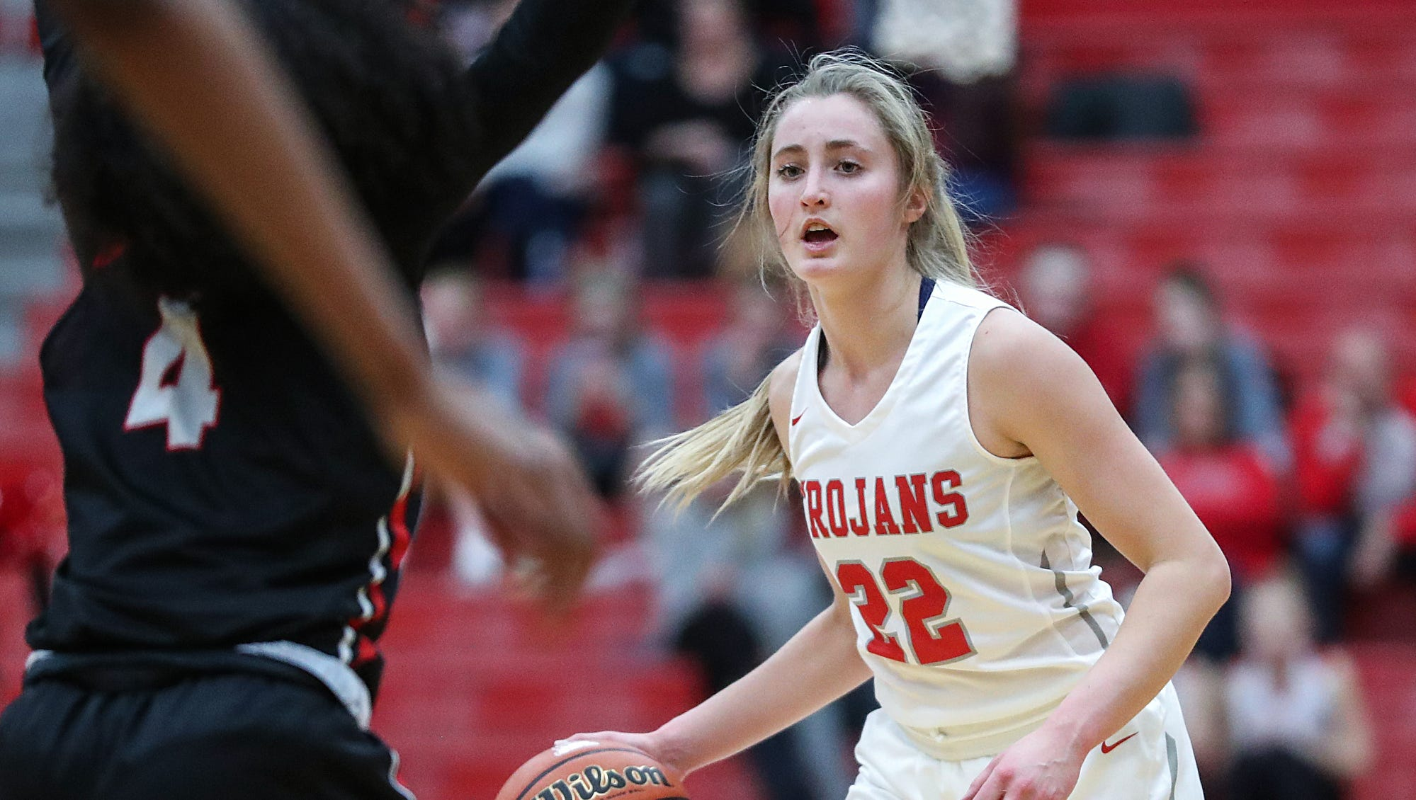 Center Grove Trojans Ella Thompson (22) works a...