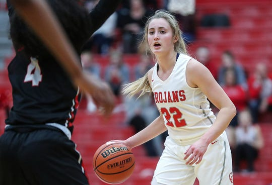 Center Grove Trojans Ella Thompson (22) works a possession in the first half of the game at Center Grove High School in Greenwood, Ind., Thursday, Jan. 10, 2019. Center Grove defeated North Central, 51-44.