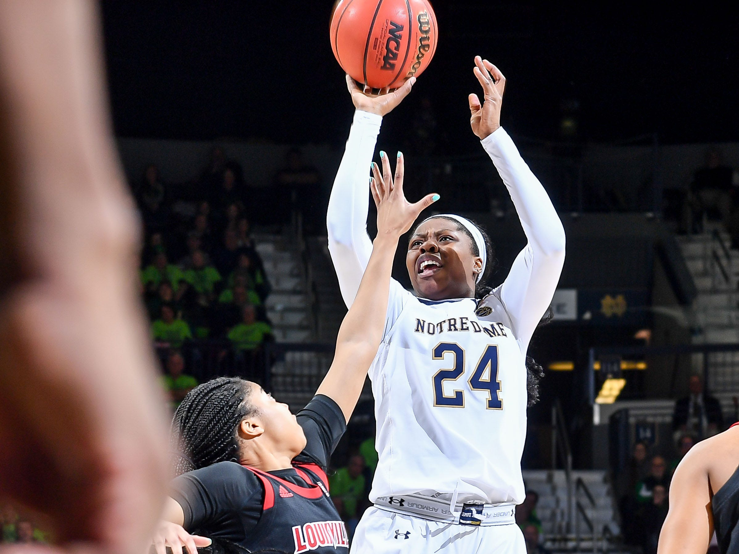 Jan 10, 2019; South Bend, IN, USA; Notre Dame Fighting Irish guard Arike Ogunbowale (24) shoots over Louisville Cardinals guard Arica Carter (11) in the second half at the Purcell Pavilion. Mandatory Credit: Matt Cashore-USA TODAY Sports