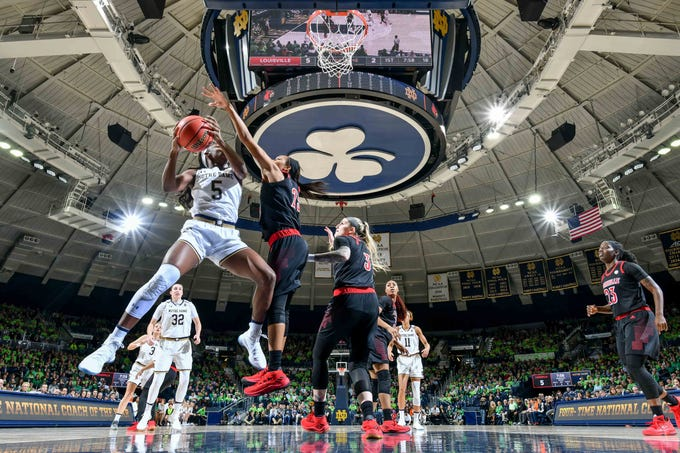 Jan 10, 2019; South Bend, IN, USA; Notre Dame Fighting Irish guard Jackie Young (5) goes up for a shot as Louisville Cardinals guard Asia Durr (25) defends in the first half at the Purcell Pavilion. Mandatory Credit: Matt Cashore-USA TODAY Sports