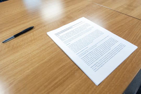 A communication agreement that mayors from Iowa City, Coralville and North Liberty signed is seen on Friday, Jan. 11, 2019, at MERGE in downtown Iowa City, Iowa.