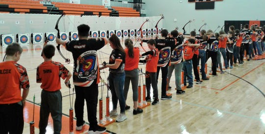 Extremely strict safety requirements allow 50 archers at a time to fire off arrows during a student tournament, such as this group at the Solon High School gym on Jan. 5.