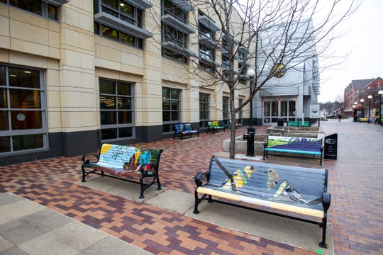 Painted benches are seen on Friday, Jan. 11, 2019, along the pedestrian mall in downtown Iowa City, Iowa. The city plans to remove this style of bench in its next phase of ped mall updates.