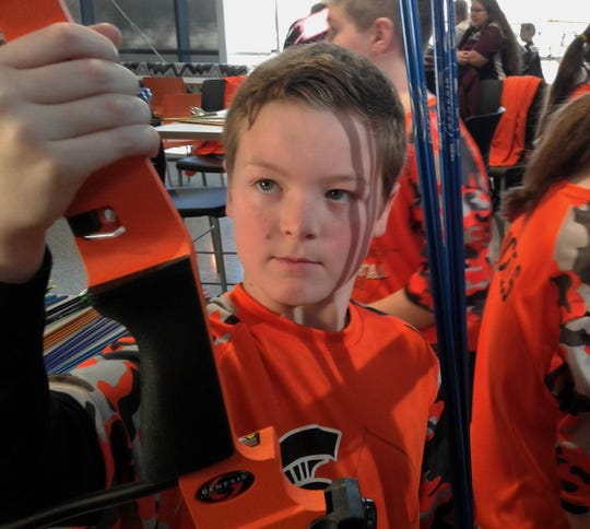 At age 11, Charlie Pettit of Solon is in his first year of the DNR-sponsored Iowa Archery in the Schools program.  Students use compound bows like this one and compete shooting from 10 and 15 meters.