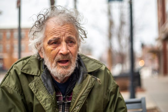 Jack Edward Waters, of Coralville, talks while sitting on a bench next to his friend's car on Friday, Jan. 11, 2019, in downtown Iowa City, Iowa. Waters was involved in a physical confrontation with an Iowa City police officer Sunday after the officer was dispatched to perform a welfare check on him.