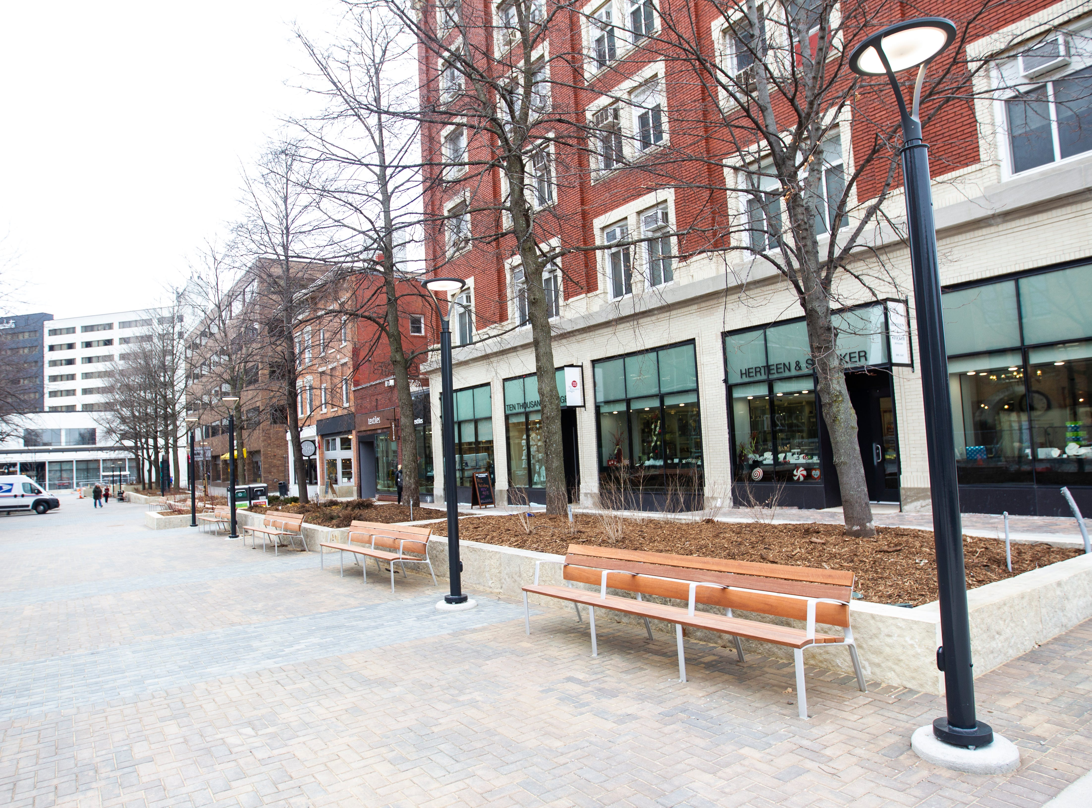 New benches with handrails are seen on Friday, Jan. 11, 2019, along the pedestrian mall in downtown Iowa City, Iowa.