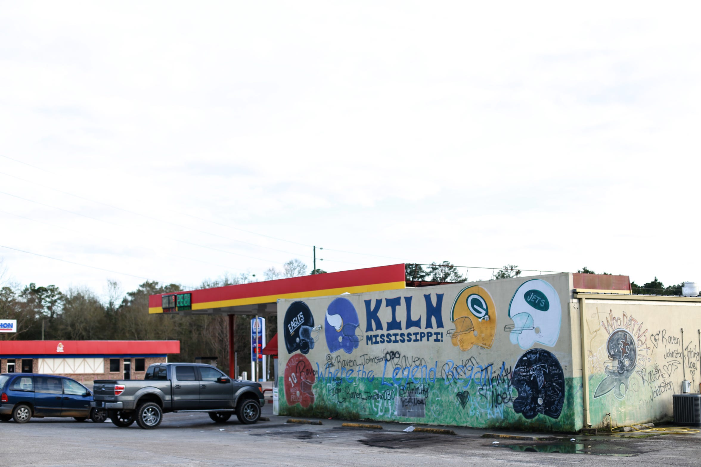 The exterior walls at Dolly's Quick Stop pay homage to hometown football hero Brett Favre and the New Orleans Saints.