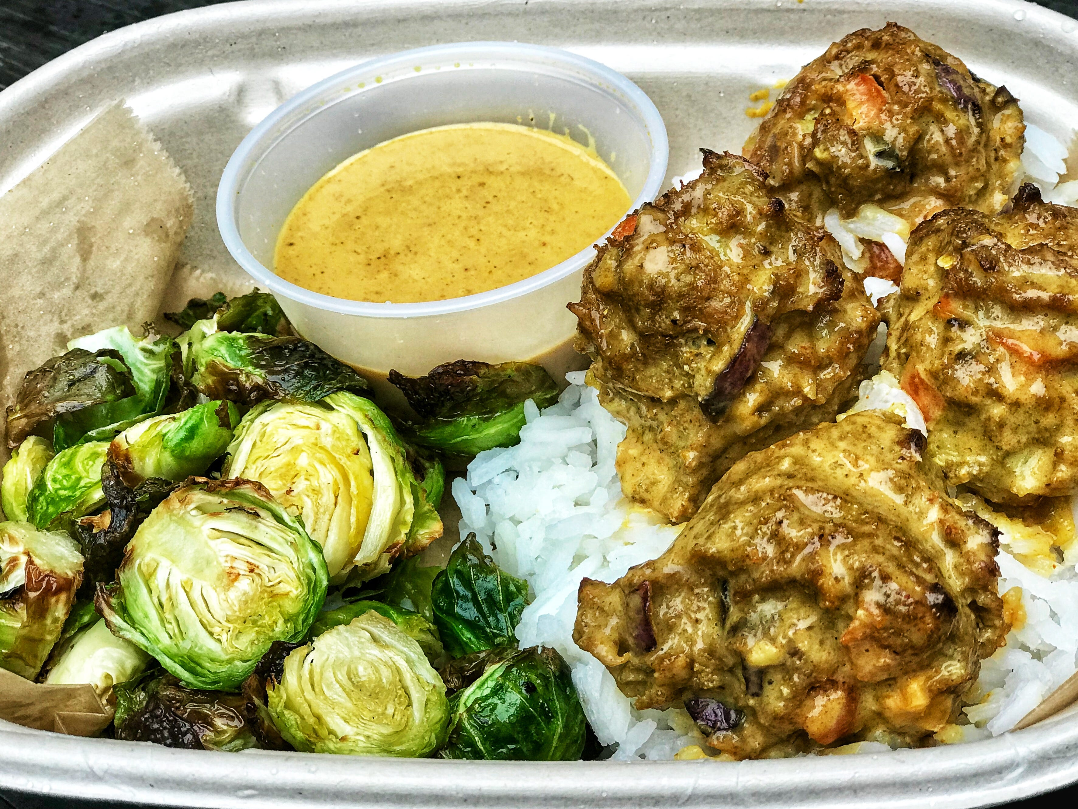 Fittest Kitchen has launched a meal prep service, which includes menu items like the Thai turkey meatballs with rice and Brussels sprouts.