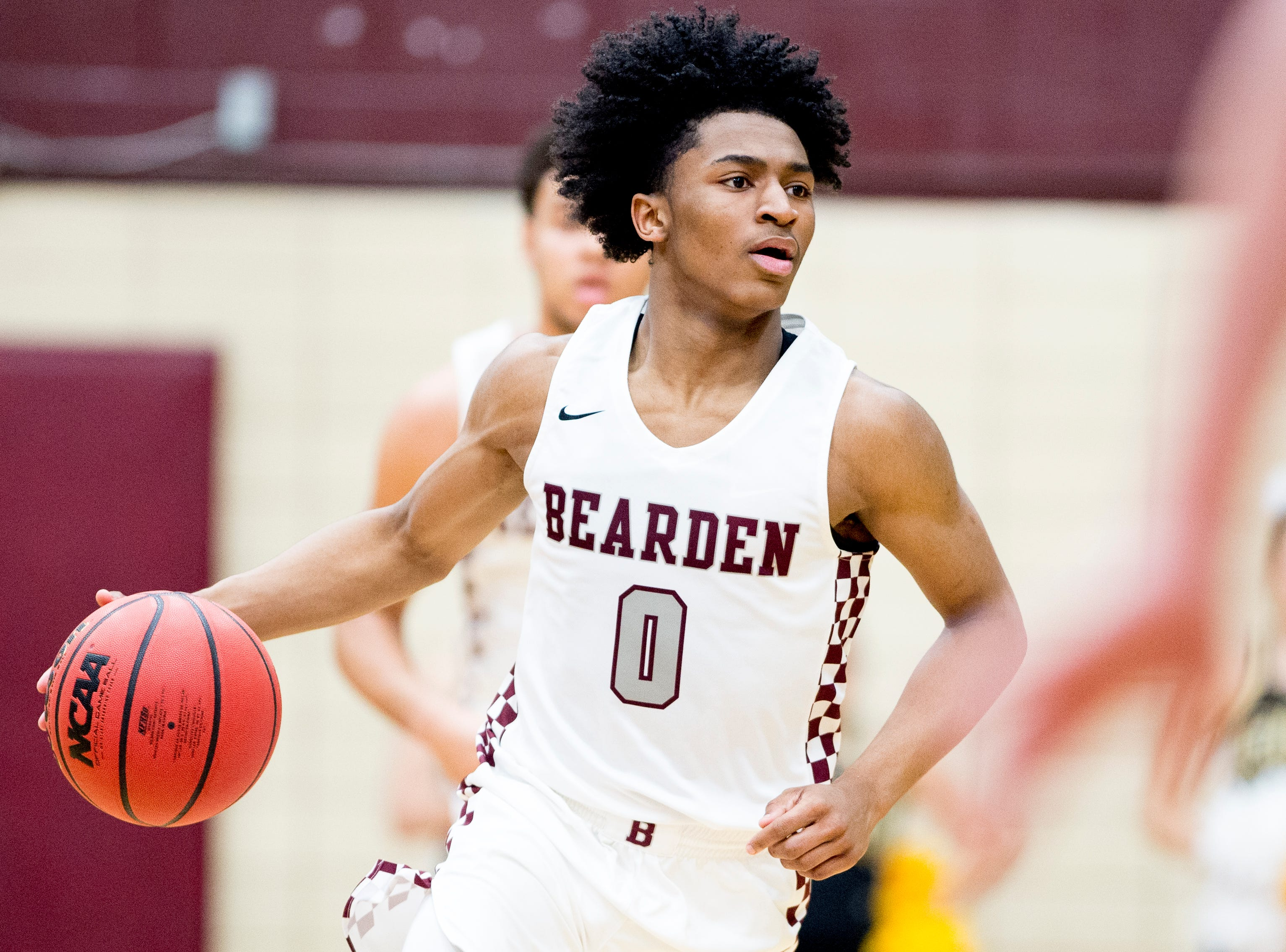 Bearden's Ques Glover (0) dribbles down the court during a game between Bearden and Catholic at Bearden High School in Knoxville, Tennessee on Thursday, January 10, 2019.