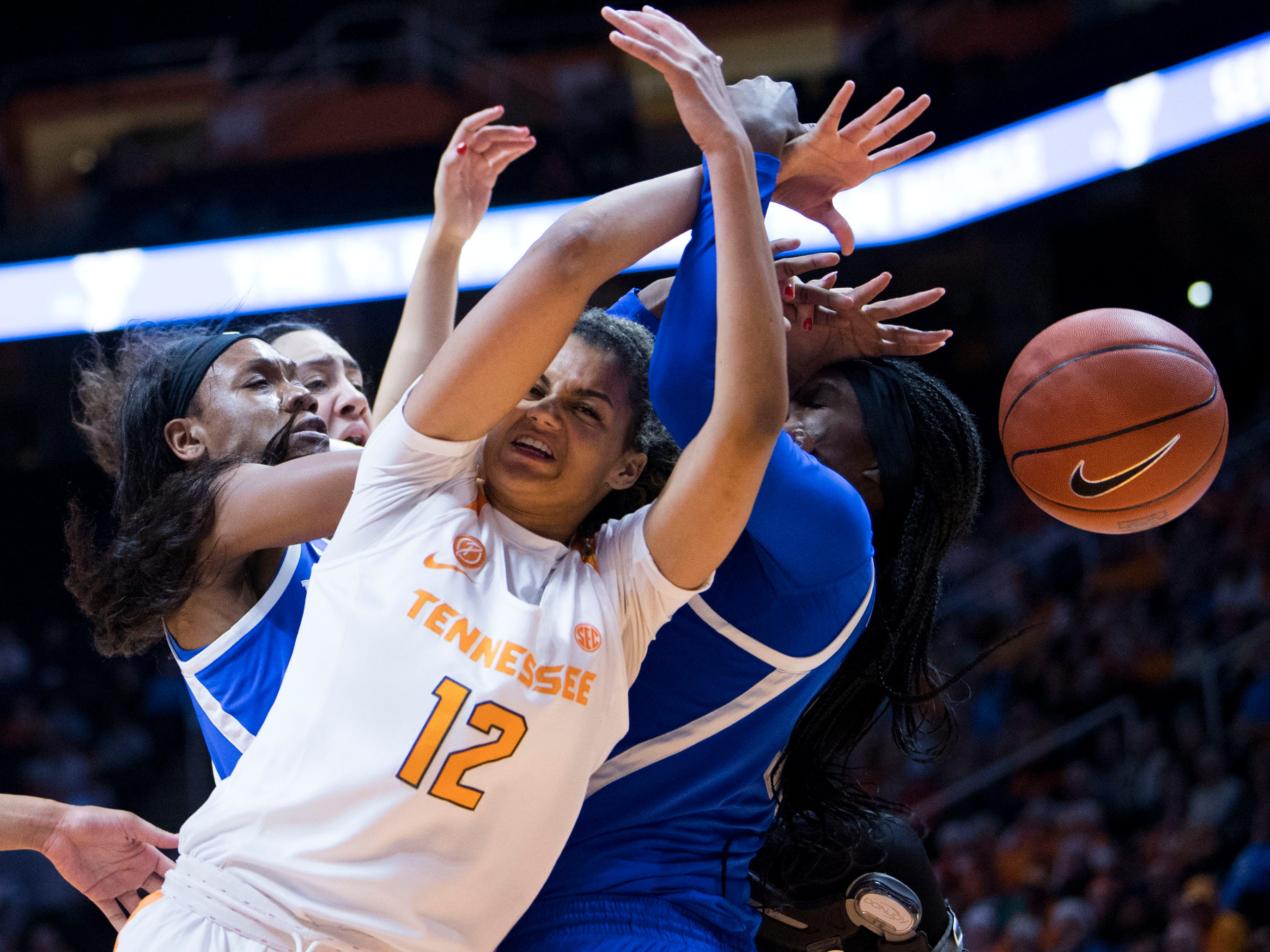 Tennessee's Rae Burrell (12) and Kentucky players get tangled up going after the rebound on Thursday, January 10, 2019.
