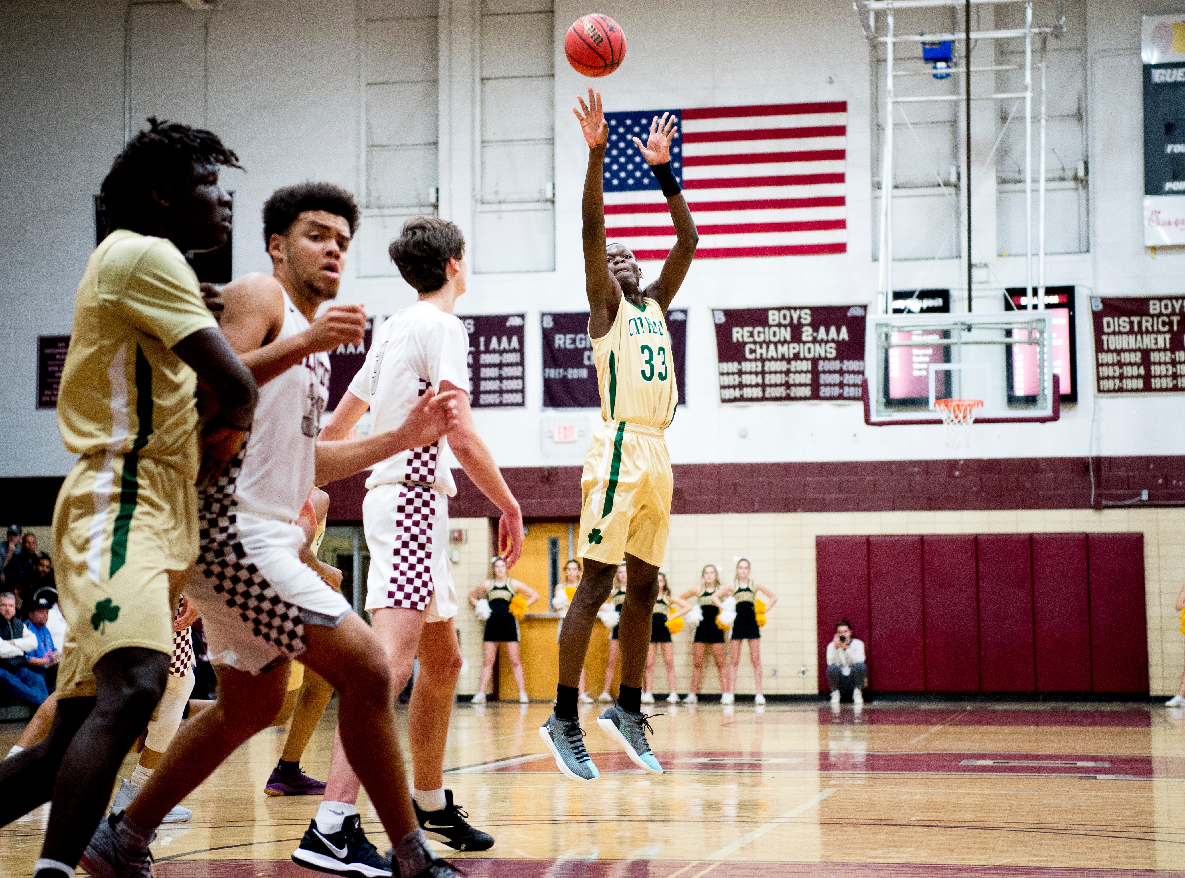 Catholic's Handje Tamba (33) shoots the ball during a game between Bearden and Catholic at Bearden High School in Knoxville, Tennessee on Thursday, January 10, 2019.
