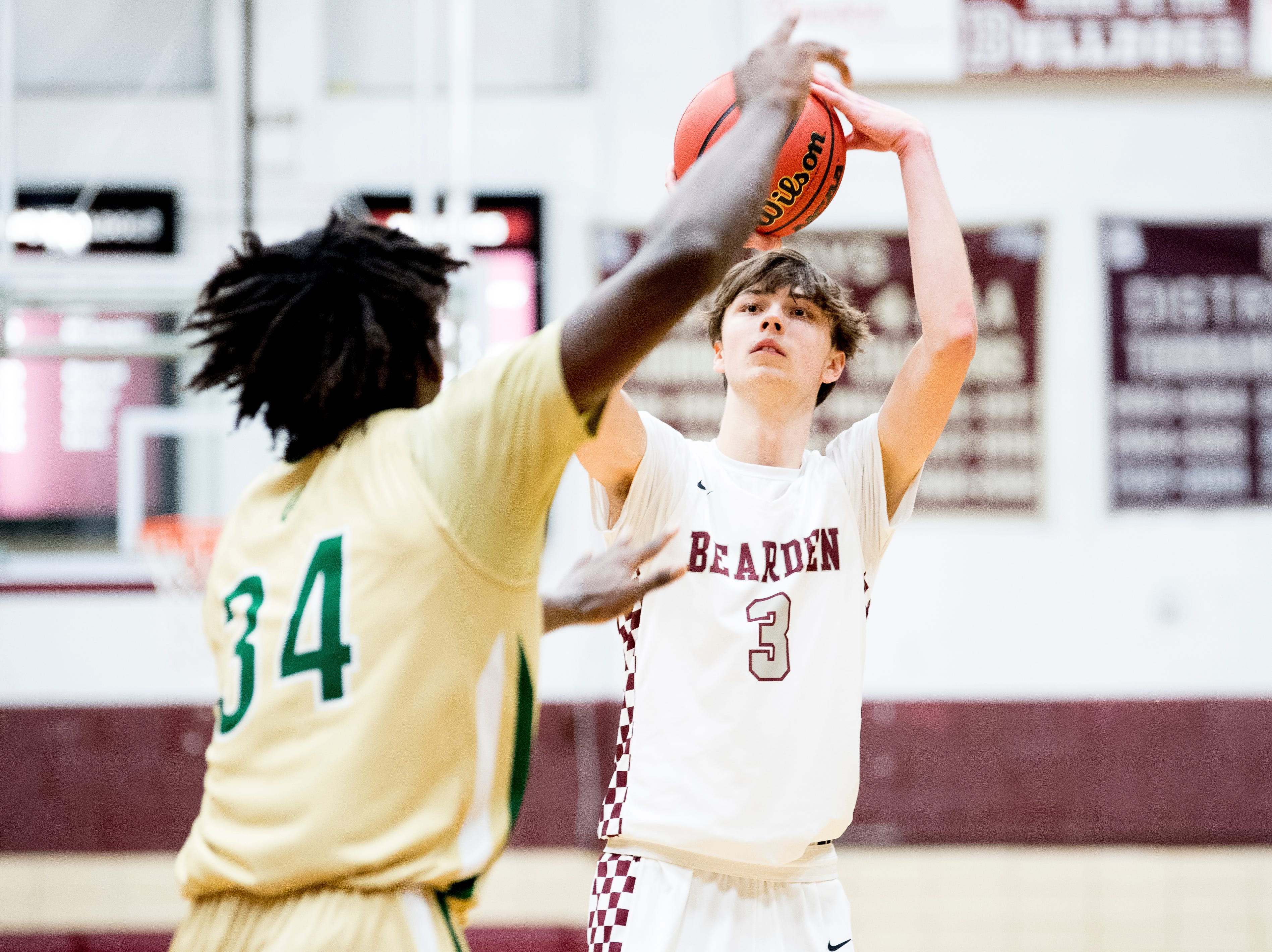 Bearden's Drew Pember (3) shoots the ball past Catholic's Akeem Odusipe (34) during a game between Bearden and Catholic at Bearden High School in Knoxville, Tennessee on Thursday, January 10, 2019.