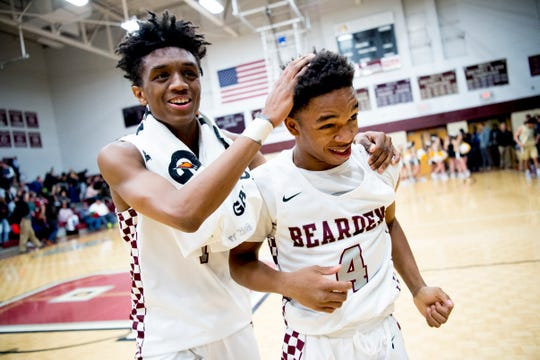 Bearden's Trent Stephney (1) congratulates Izaiha Bredwood (4) at the end of the game on a play during a game between Bearden and Catholic at Bearden High School in Knoxville, Tennessee on Thursday, January 10, 2019.