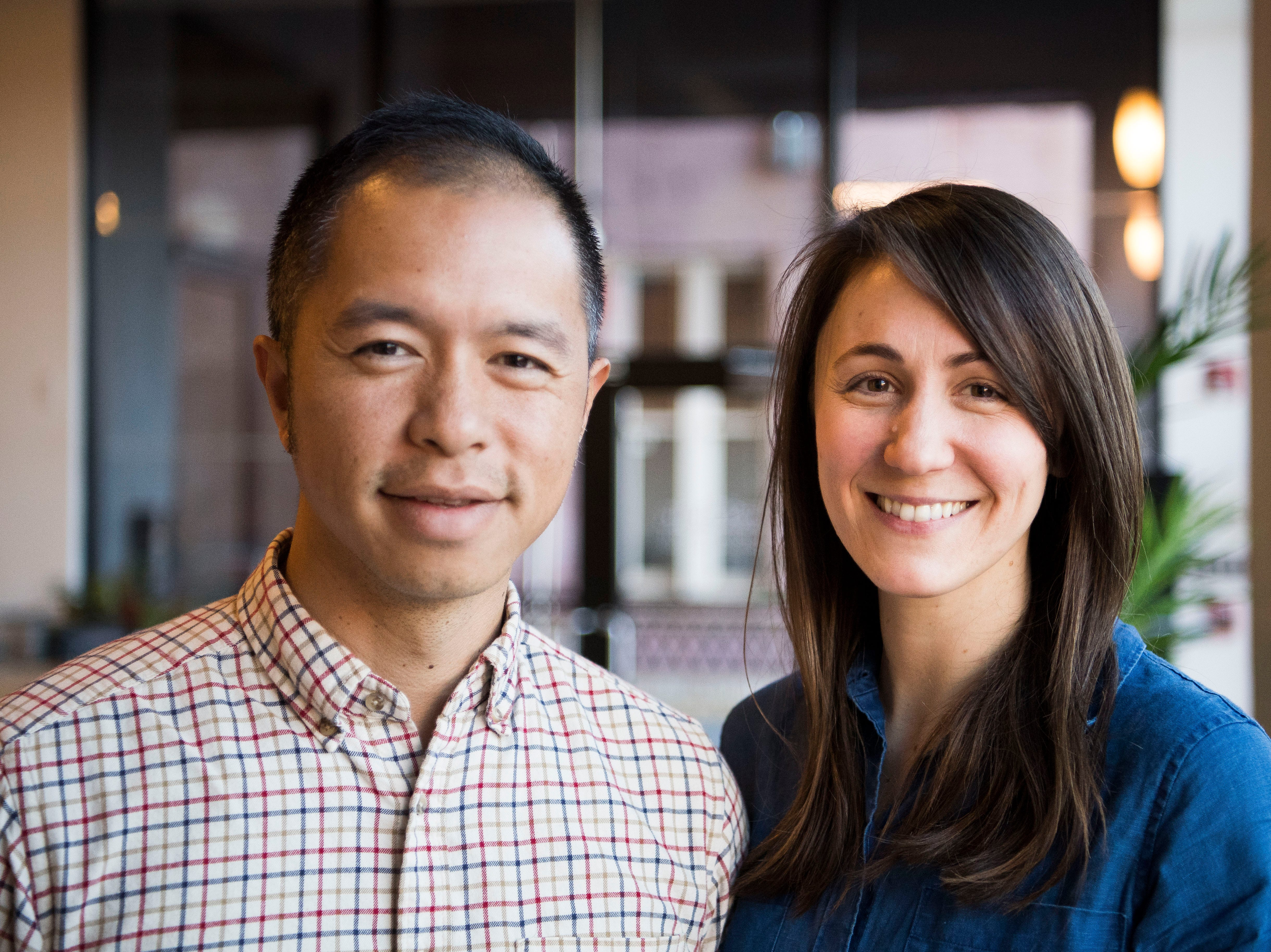 Kevin Ling and his wife Sydney Berry Ling, co-owners of Red Chair Workspaces, pose for a photo in the space Wednesday, Jan. 9, 2019.