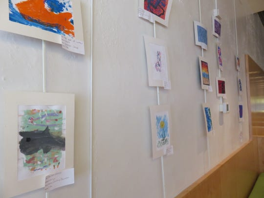 Pieces of art by Bearden Middle School students adorn the walls of the Tomato Head restaurant in Market Square.