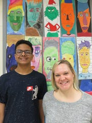 Art student Ayaz Sultan, left, with teacher Jessie Winston. Sultan is one of 100 students whose work is on display at the Tomato Head restaurant.