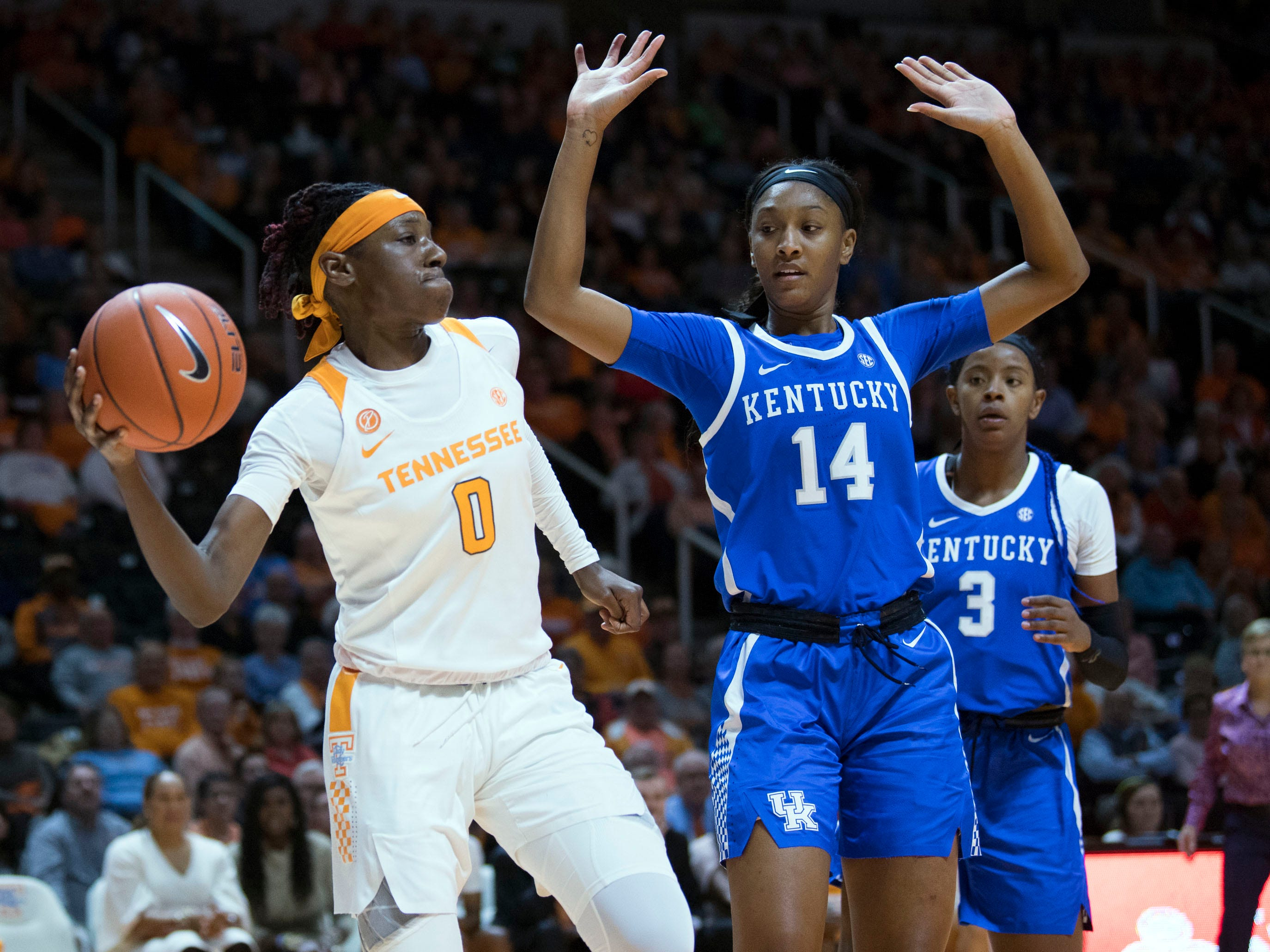 Tennessee's Rennia Davis (0) passes the ball while guarded by Kentucky's Tatyana Wyatt (14) on Thursday, January 10, 2019.