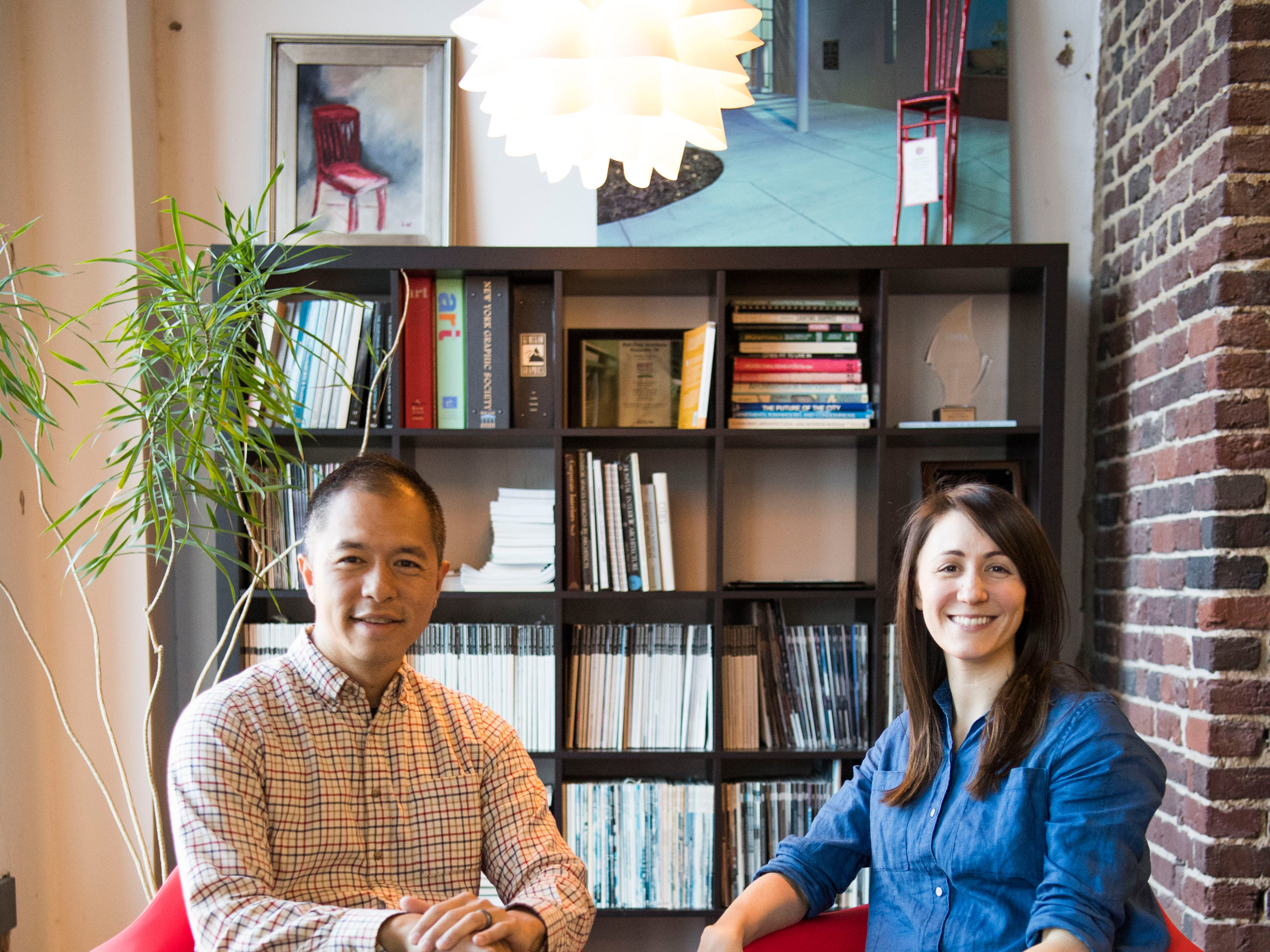 Kevin Ling and his wife Sydney Berry Ling, co-owners of Red Chair Workspaces, pose for a photo in the space Wednesday, Jan. 9,2019.