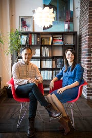 Kevin Ling and his wife Sydney Berry Ling, co-founders of Red Chair Workspaces, pose for a photo in the space Wednesday, Jan. 9,2019.