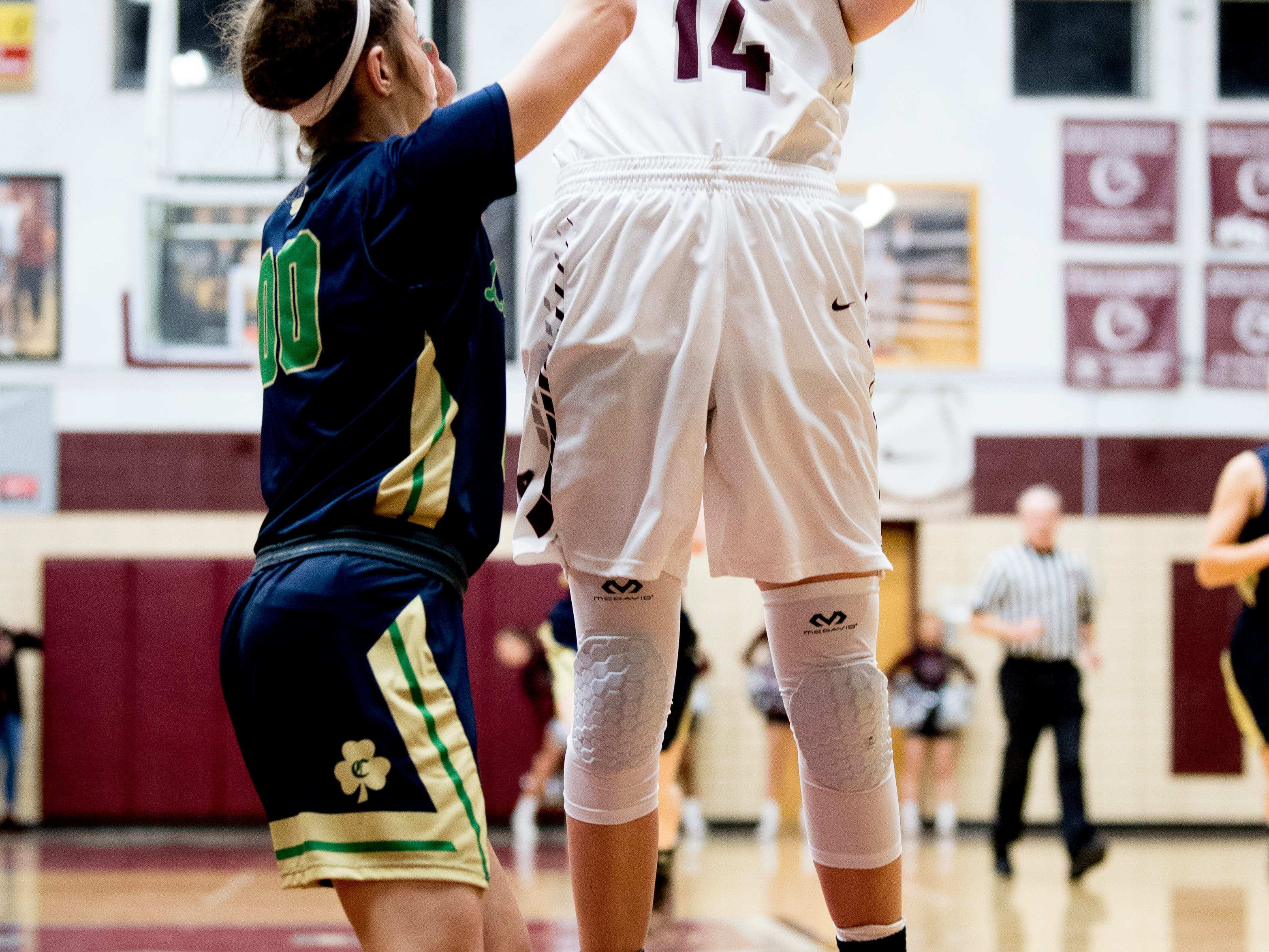 Bearden's Annaka Hall (14) shoots past Catholic's Natalie Perry (00) during a game between Bearden and Catholic at Bearden High School in Knoxville, Tennessee on Thursday, January 10, 2019.