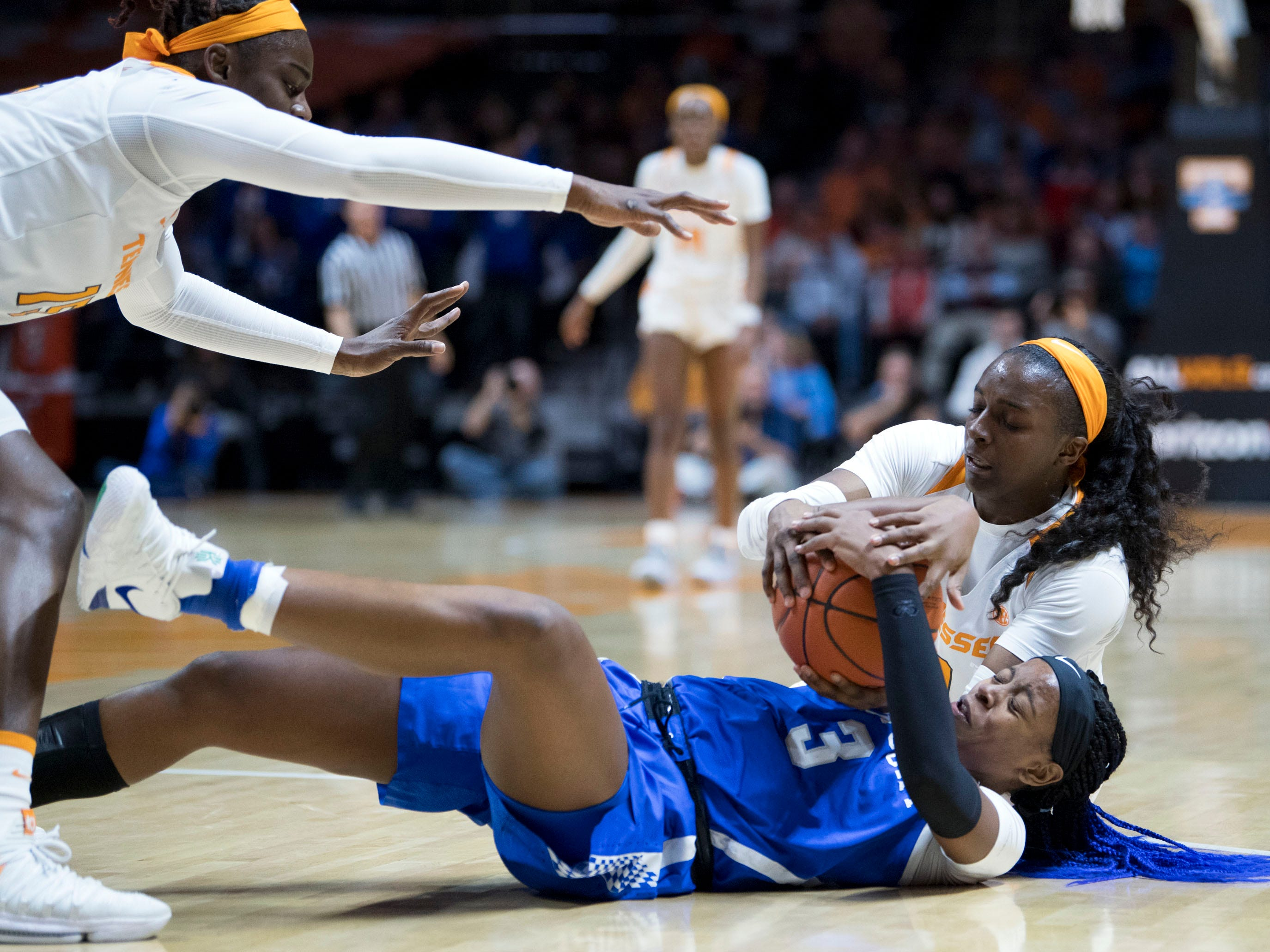 Kentucky's KeKe McKinney (3) tries to protect the ball from Tennessee's Meme Jackson (10) and an approaching Cheridene Green (15) on Thursday, January 10, 2019.