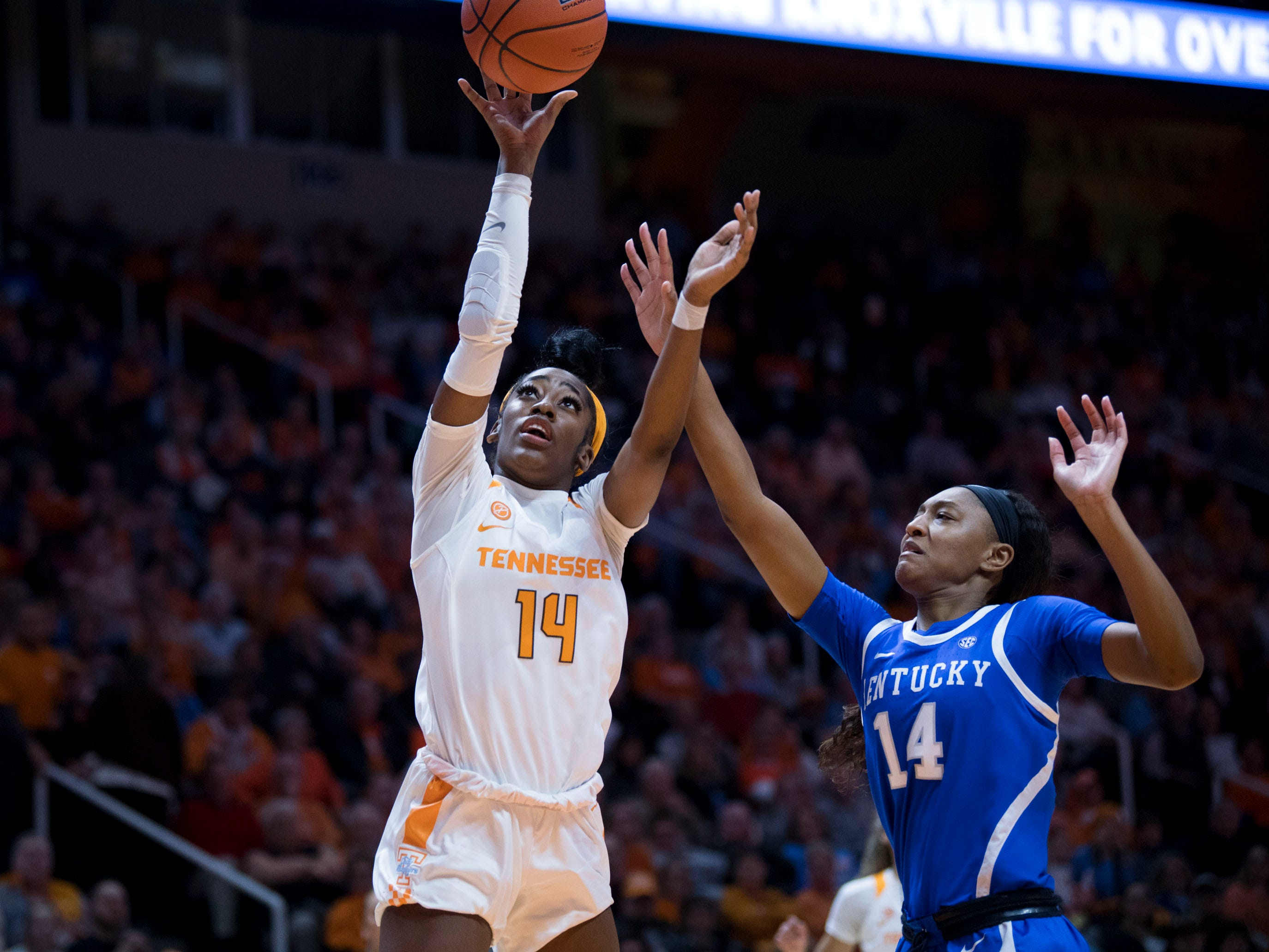 Tennessee's Zaay Green (14) shoots and scores while guarded by Kentucky's Tatyana Wyatt (14) on Thursday, January 10, 2019.