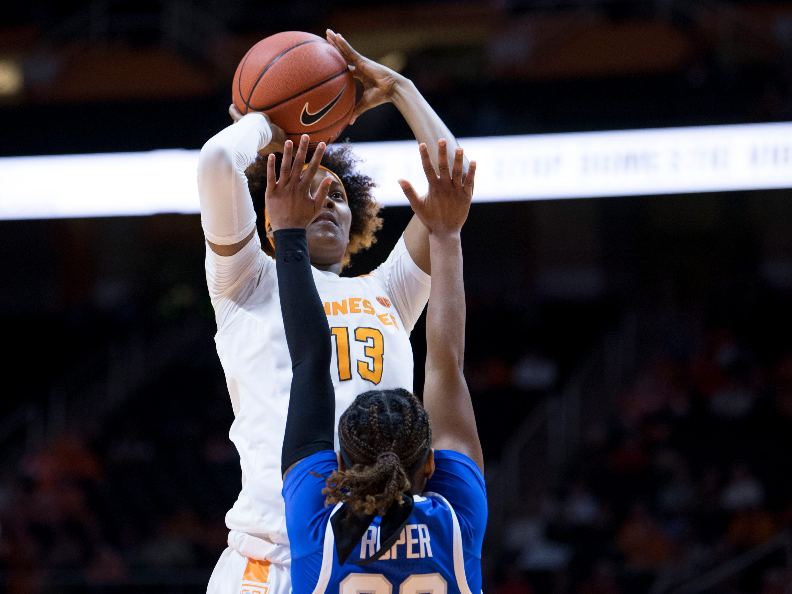 Tennessee's Jazmine Massengill (13) attempts to score while guarded by Kentucky's Jaida Roper (32) on Thursday, January 10, 2019.