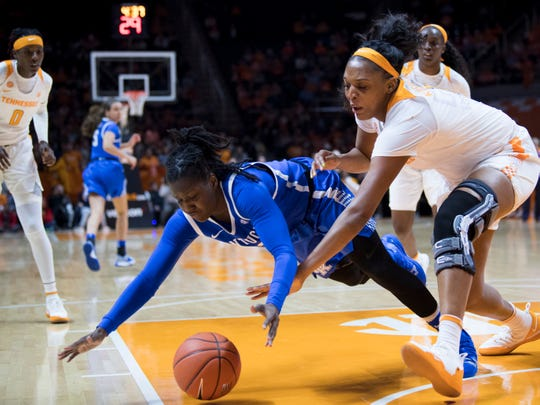 Kentucky's Amanda Paschal (12) and Tennessee's Kasiyahna Kushkituah (11) chase after the loose ball during their game at Thompson-Boling Arena on Thursday, January 10, 2019.