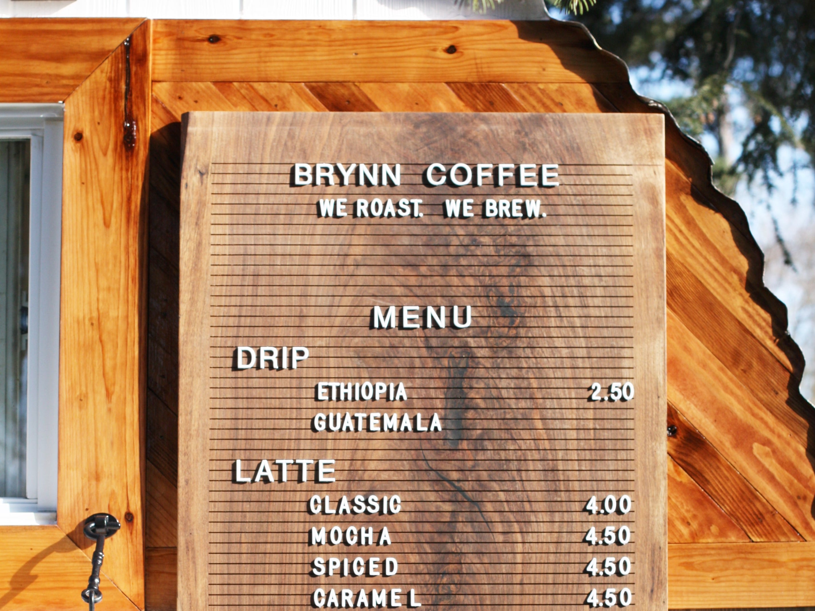 The Brynn Coffee Co menu features specialty lattes including a classic, a mocha made with Dutch chocolate syrup, a spice late and caramel latte.