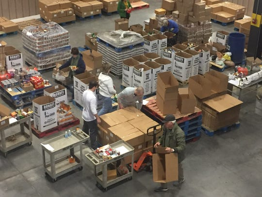 Second Harvest Food Bank workers prepare new emergency food boxes to replenish their supply after sending 92 of them to McGhee Tyson Airport Transportation Security Administration workers. TSA employees are working without pay as the government shutdown rolls on.