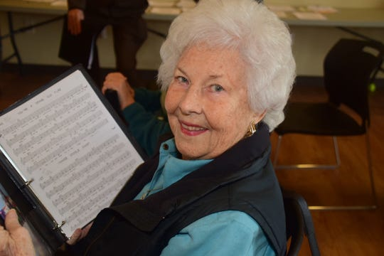 "Alto Lois McGinnis studies ""You're a Grand Old Flag"" sheet music at choir practice at Karns Senior Center Friday, Jan 4."