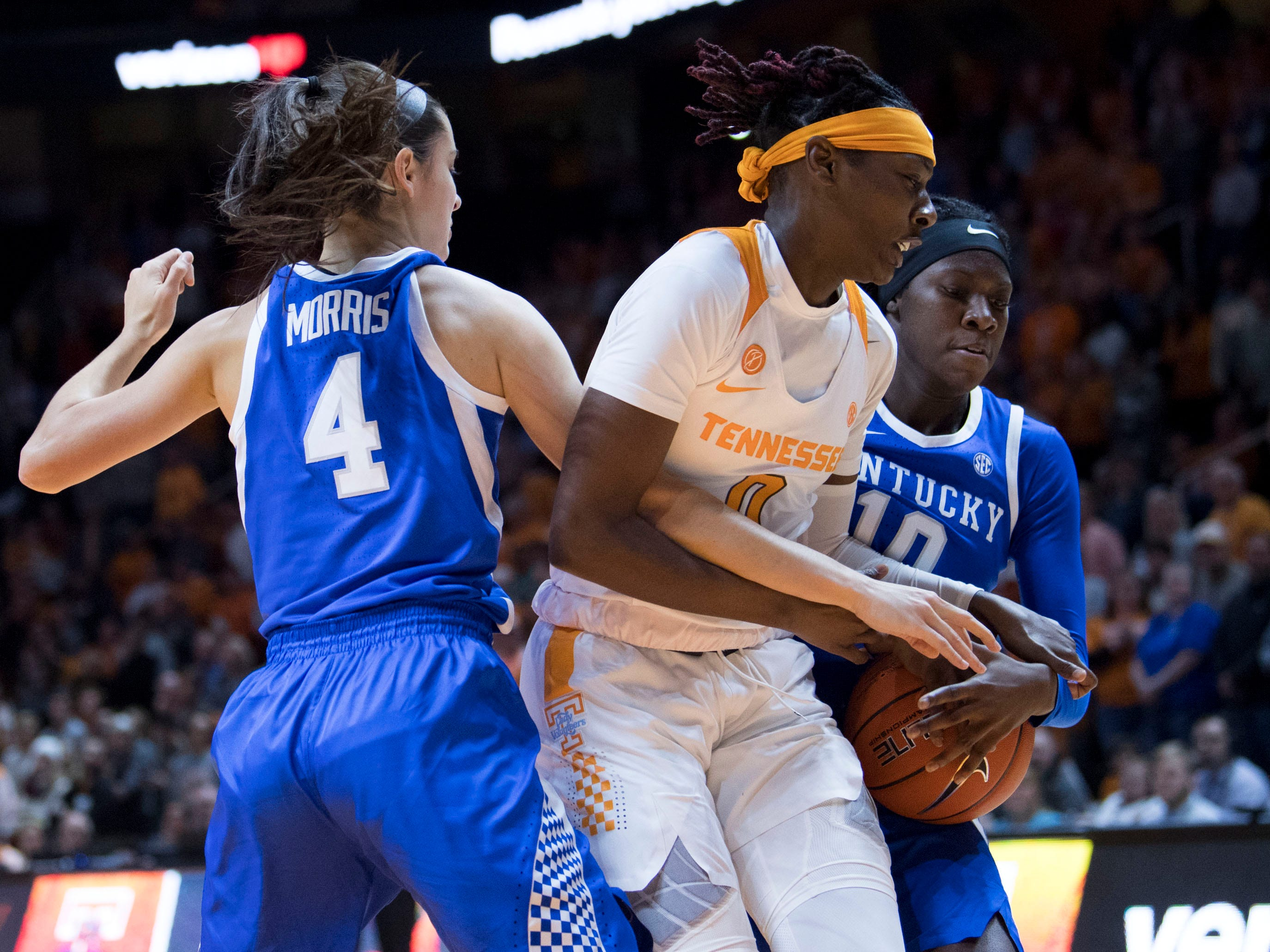 Tennessee's Rennia Davis (0) fights for the ball with Kentucky's Maci Morris (4) and Rhyne Howard (10) on Thursday, January 10, 2019.